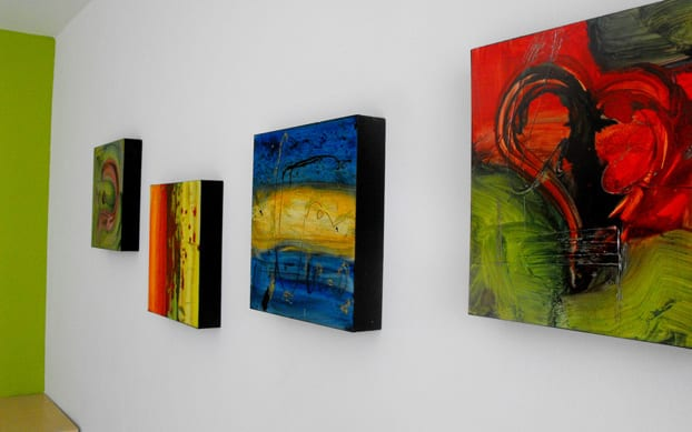 How to Decorate a Bare Wall with Canvas Prints and Other Wall Arts