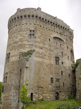 Photo: The Chateau de Dinan, also called Donjon de la duchesse Anne (Keep of the Duchess Anne), and stands 174 feet high. John V, Duke of Brittany built the keep in 1384. (A keep or [in French] donjon - from which we derive our word dungeon - is a fortified tower which forms the heart of a castle.) Here it is a high tower with an oval section; a moat divides the keep from the outside of the ramparts as well as from the inside of the city. The machicolation (a floor opening between the supporting corbels, through which stones and lethally hot liquids could be dropped on attackers at the base) overhangs 100 feet of stone walls.