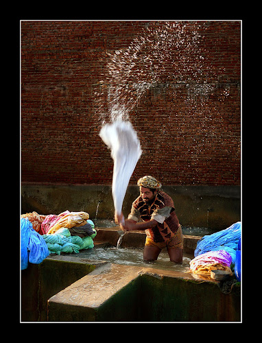 Washing Dirty Linen by Sami Ur Rahman - Professional People Factory Workers ( water drops, washing linen, light & shade, age-old methods, washerman )