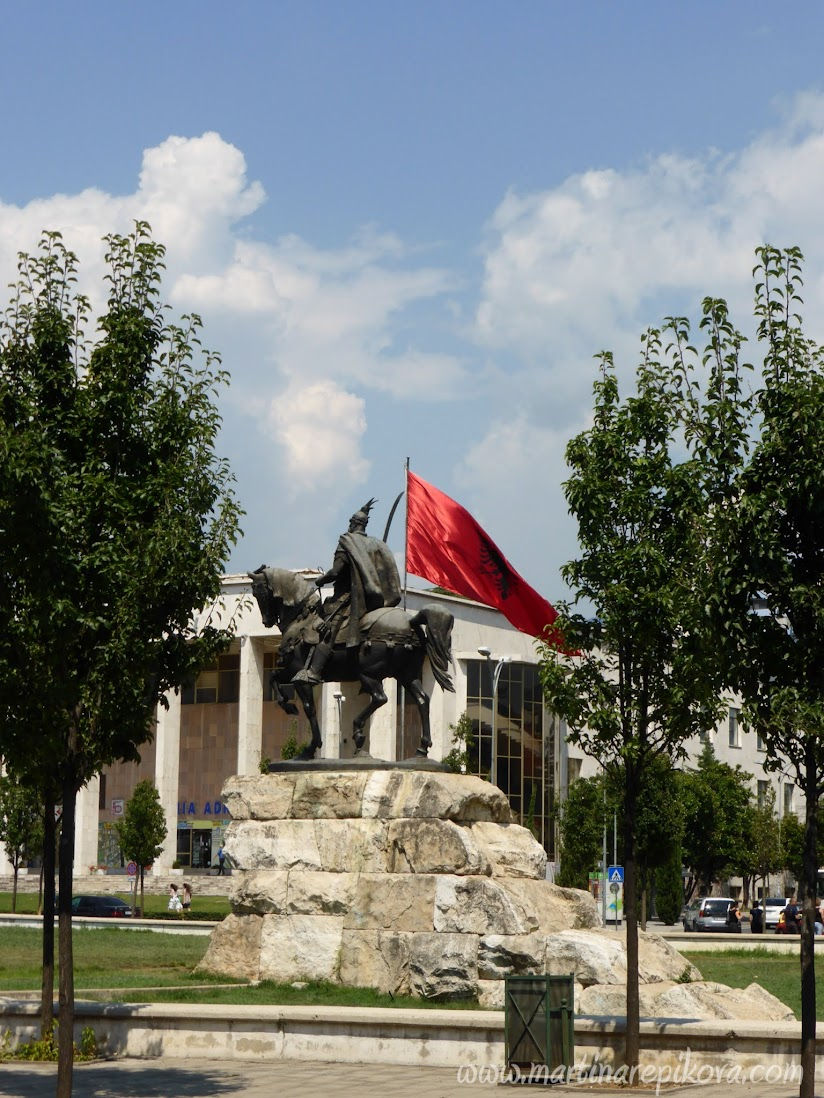 Statue of Skanderbeg with the Cultural Palace in the background, Tirana, Albania