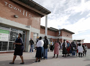 Physical-distancing guidelines are ignored in the queue outside Town Clinic, Khayelitsha, Cape Town.