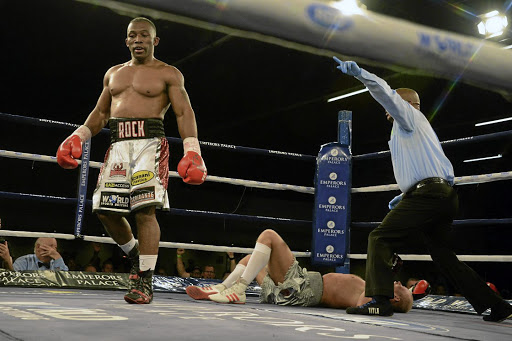 Thabiso 'The Rock' Mchunu walks away after flattening Ricards Bolotniks of Latvia in the sixth round at Emperors Palace on Saturday night. Mchunu next meets Thomas Oosthuizen in September in an eagerly awaited bout.