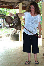 Photo: Tracey holding a coconut for the monkey to spin and kick off.
