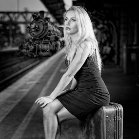 Waiting for the train by Chris O'Brien - Black & White Portraits & People ( girl, location, black and white, woman, blond, train, beauty, black dress,  )