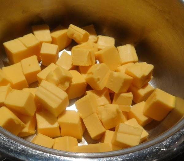 Melt the 16 ounces of cubed Velveeta cheese and the 2/3 cup of milk....