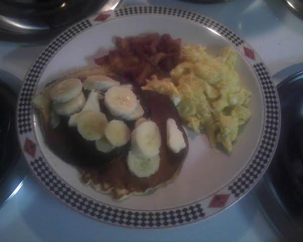 This Is What I Had For Breakfast. My Favorite Pancakes Topped With Bananas, Bacon And Scrambled Eggs.