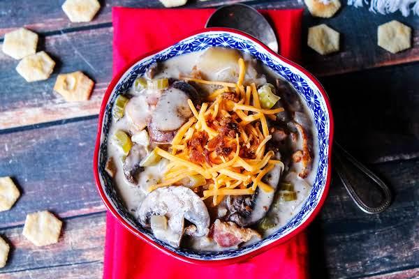 Crock Pot Potato Bacon Soup In A Bowl.