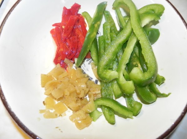 Get your peppers sliced up and ready.  (Use any peppers you want; the more the...