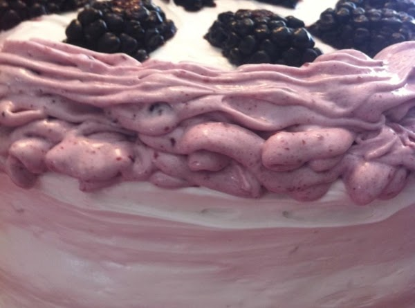 Frost with whipped cream frosting and decorate with remaining blackberries.  NOTE: If you...