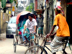 Photo: Dhaka transport. note the extra bumpers on the car - they're used.