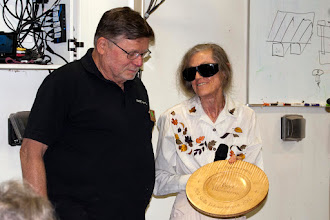 Photo: Dick Webster turned this curly maple platter, and Margaret Follas chip carved it -- as a gift to Bert Bleckwenn for his years of devoted service to the Skills Enhancement Program and its participants.