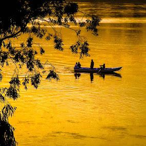 by Muhammad Gujjar - Landscapes Waterscapes ( boat, evening, golden, river, , #GARYFONGDRAMATICLIGHT, #WTFBOBDAVIS )