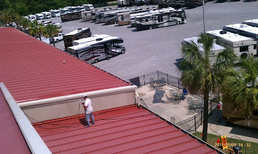 Photo: ON THE ROOF PRESSURE WASHING AT DIXIE RV
