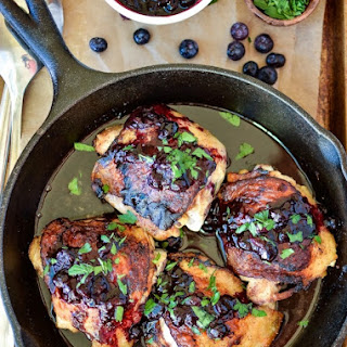 Crispy Chicken Thighs with Blueberry Sauce.
