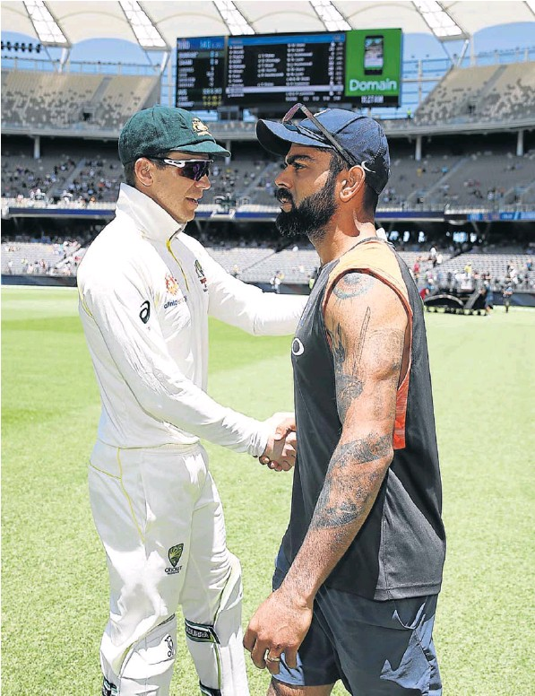 Tim Paine, of Australia, shakes hands with Virat Kohli, of India, after Australia claimed victory during day five of the second match at Perth Stadium on Tuesday