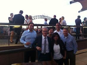 Photo: Tbirds in Sydney, Australia met at the Opera Bar. From left to right: Ryan McCumber '00, Douglas Marcotte '93, Mari Suzuki '91, Pragya Uprety '12, Roger Shahani '94, and Keith Meyer '92