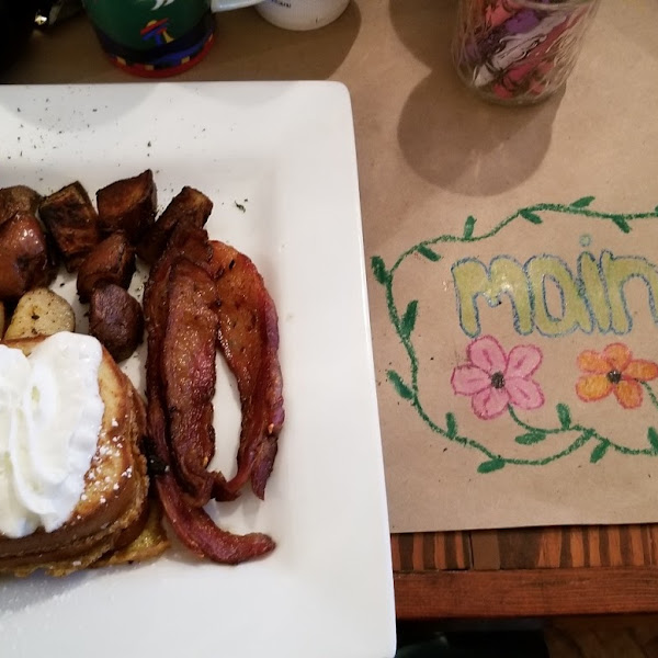 Butterscotch stuffed french toast with home fries and lamb bacon.