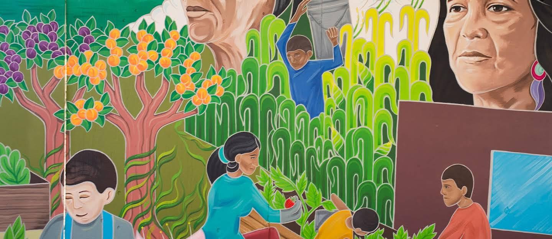 A mural of  people harvesting vegetables.