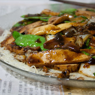 King Oyster Mushroom And Tofu In Black Bean Sauce On Crispy Rice Vermicelli.