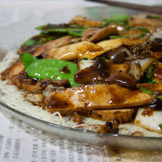 King Oyster Mushroom And Tofu In Black Bean Sauce On Crispy Rice Vermicelli.