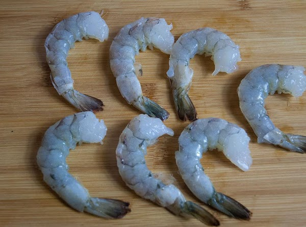 Remove the shells (leave the tails) from the shrimp, and devein. Reserve the shells.