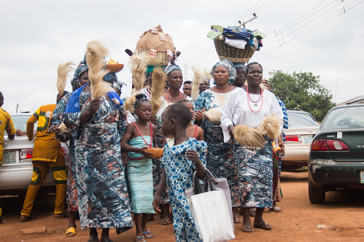Different groups arrive at the Ogidi New Yam Festival in their unique attires