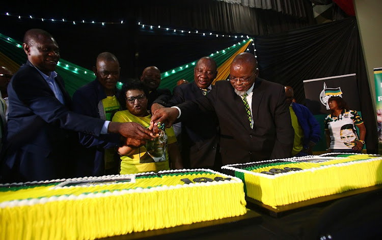 Members of the ANC Top 6 cut a cake during the ANC 106 birthday celebration held at East London City Hall. Picture: MASI LOSI