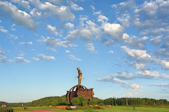 Photo: A 35-ft tall miner stands atop a spherical structure over steel beams piled on taconite rocks.
