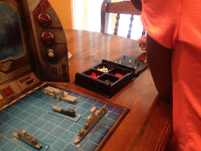 Photo: My daughter set up our battle ships. We were able to get in a few attacked while the nuggets and fries cooked.