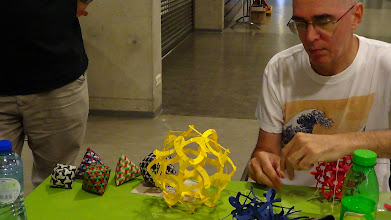 Photo: Skew mad weave polyehdra by Paul Gailiunas (on the left) and George Hart on the right assembling his trio paper structures (which can transport in a small envelope). I've seen the envelope!!