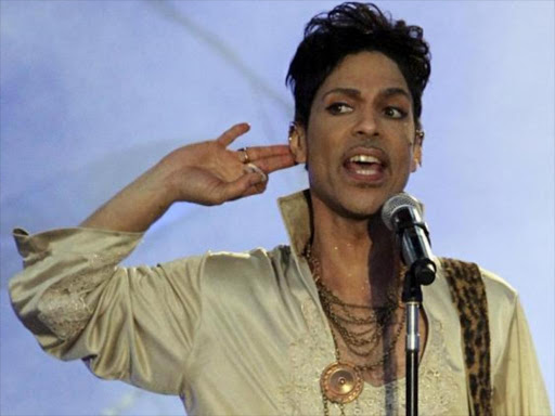 US musician Prince performs at the Hop Farm Festival near Paddock Wood, southern England July 3, 2011. Photo/REUTERS