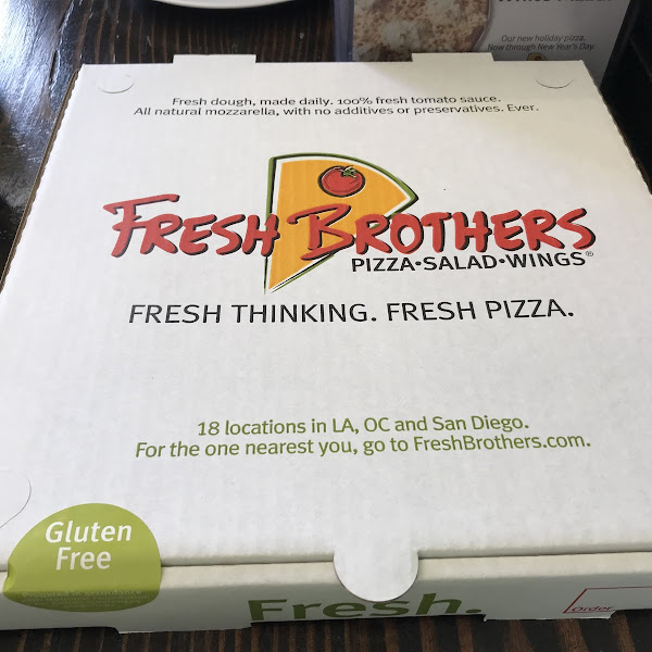 They not only prepare GF pizza separately, they put it in a box to prevent cross contamination. Yay!