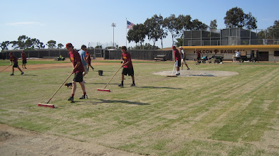 Photo: After level-lawn we use brooms to work the sand in.
