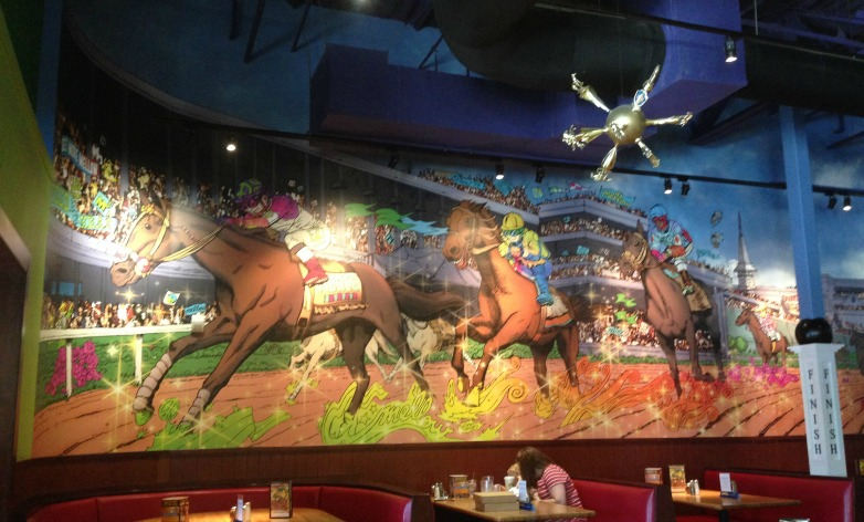 Mellow Mushroom has fun decor unique to each location, like this fun Churchill Downs-inspired decor at the Middletown, KY location.