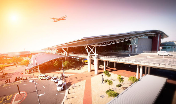 This artist's impression of the new East London Airport after its upgrades envisions a sleek and modern new departures lounge and multistorey parking.