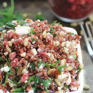 Festive Rice Salad with Fresh Herbs, Pomegranate Arils, & Feta Cheese.