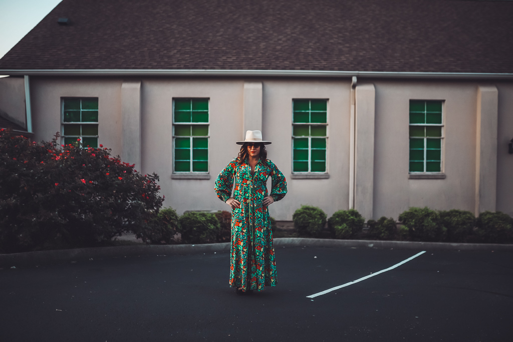 A Busy Moms Guide on How to Take Care of Your Family's Health by popular Nashville lifestyle blog, Modern Day Moguls: image of a woman outside wearing a felt fedora, floral print maxi dress, and Octagon shaped sunglasses.