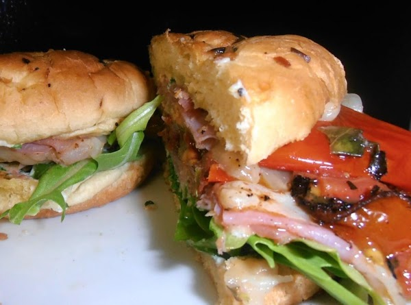 Build Laurie's sammie: On the bottom half of 4 onion rolls, assemble 1 slice...