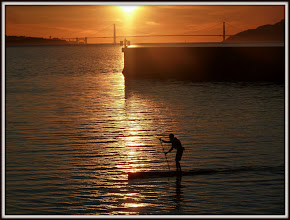 Photo: Paddle Boarder at sunset