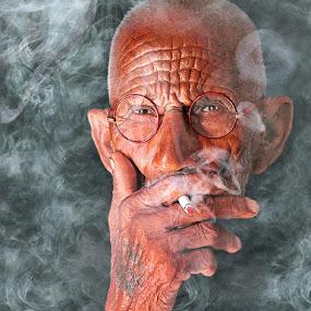 Avid Smoker by Nayyer Reza - People Portraits of Men ( cigarette, color, old man, smoke whirls, nayyer, smoke, reza,  )