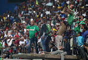 AmaZulu fans look on during the Absa Premiership match against Mamelodi Sundowns at King Zwelithini Stadium in Umlazi on March 2 2018. The AmaZulu fans threw objects at the Sundowns bench shortly after the third goal in a 3-1 win for visitors.