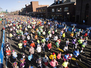 Photo: MANCHESTER 11/28/13  The crowd at the start of the 2013 Manchester Road Race takes off down Main Street. (MRR Photo by John Long)