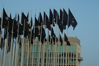 Photo: black flags raised to block view of electronic sign at u.s. interests section in havana. tracey eaton photo.