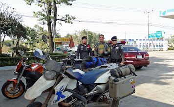 Photo: Luckily, I've never had a problem (fine, bribe etc.) with the police in any country during this trip. These officers of the Thai highway police were just having their coffee break.