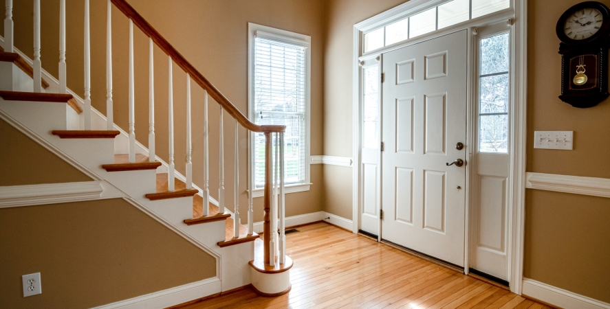 home entryway with staircase