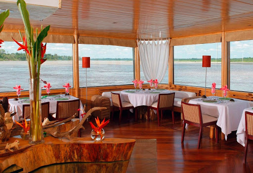 delfin-ii-dining-room.jpg - Head to the dining room on Delfin II for fresh, locally sourced cuisine.