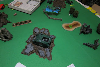 Photo: Turn 2 - end of Dark Eldar turn - the other Chaos Rhino is stuck in the stupid crater! Normal movement was fine, but tried moving in the shooting phase, rolled a 1 and got stuck, which meant no shooting from within and no disembarking from the troops inside!