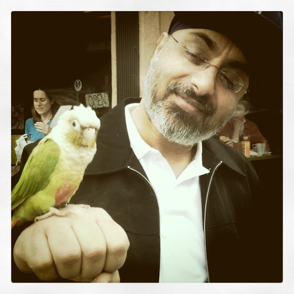 Photo: Sodhi coaching a parrot, transformation will happen