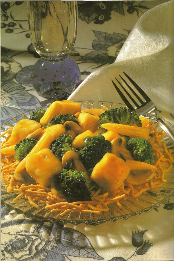 Dry tofu on paper towels. Cut tofu into1 inch cubes. Place 2 tablespoons cornstarch...