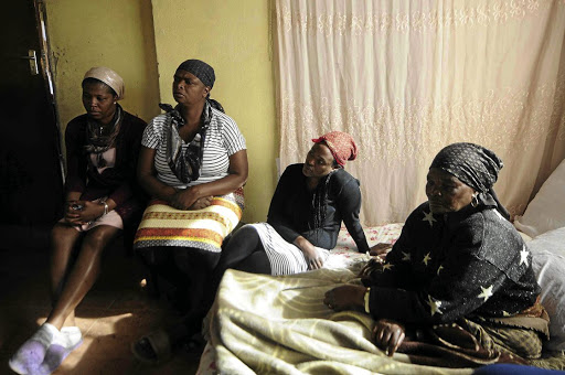 Pearl Manana, Elizabeth Ntsanwisi, Tsakane Ntsanwisi and Rose Mkhondwane mourn the death of their relative Piet Ntsanwisi at Chris Hani Baragwanath Hospital.